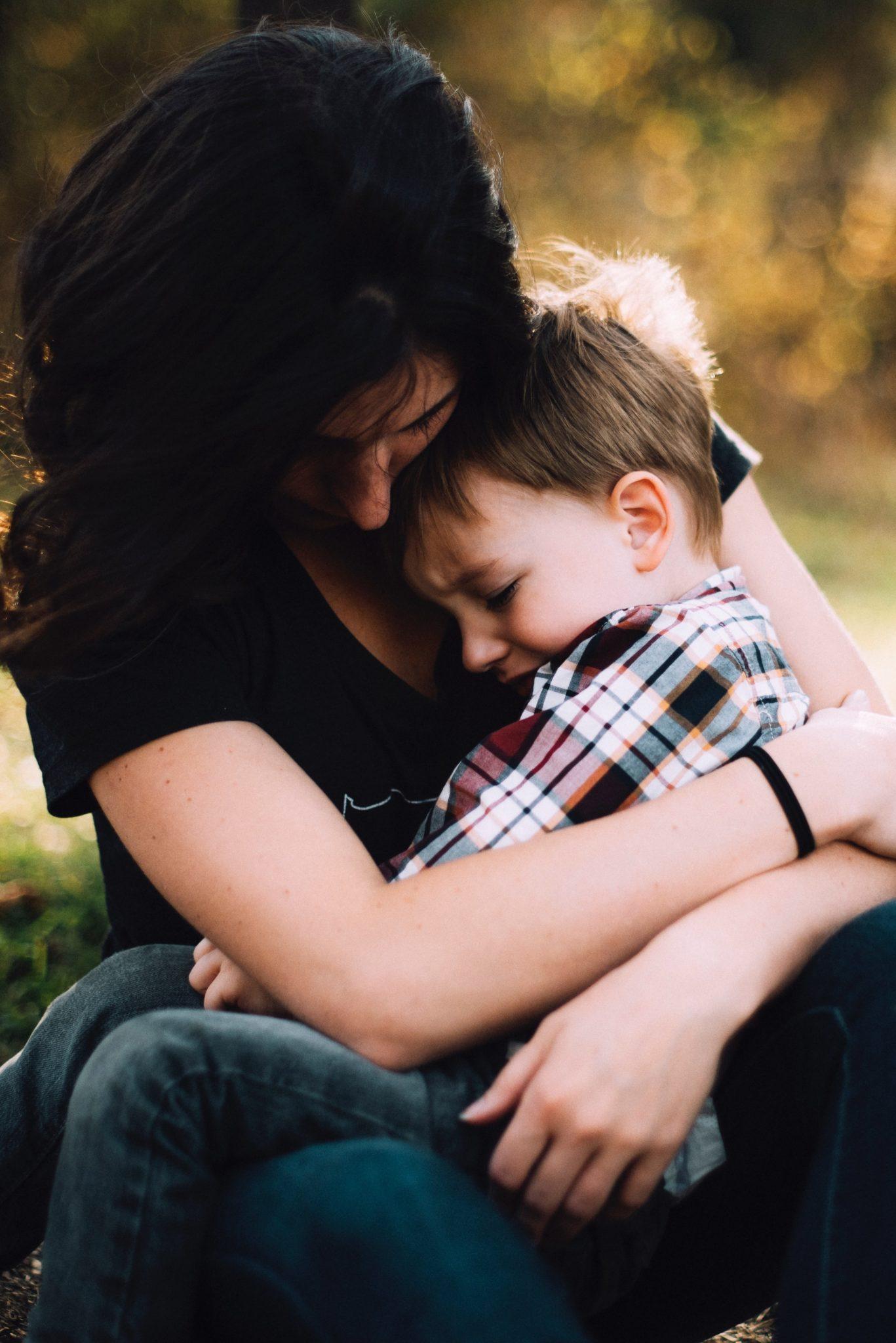 mom holding upset child